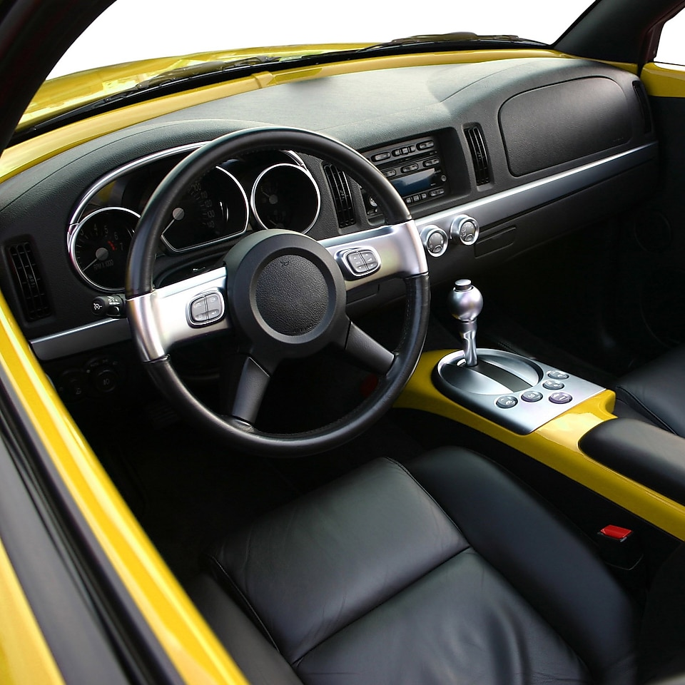 Interior of a Chevrolet SSR, showing dashboard, sat, and steering wheel