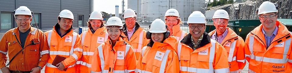Christina wearing hardhat with colleagues