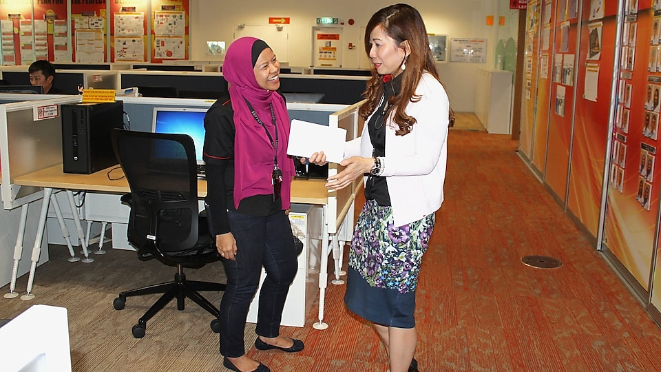 Maria discussing work with Siti Sulaiman, GM Global Operations Commercial Services (GOCS)