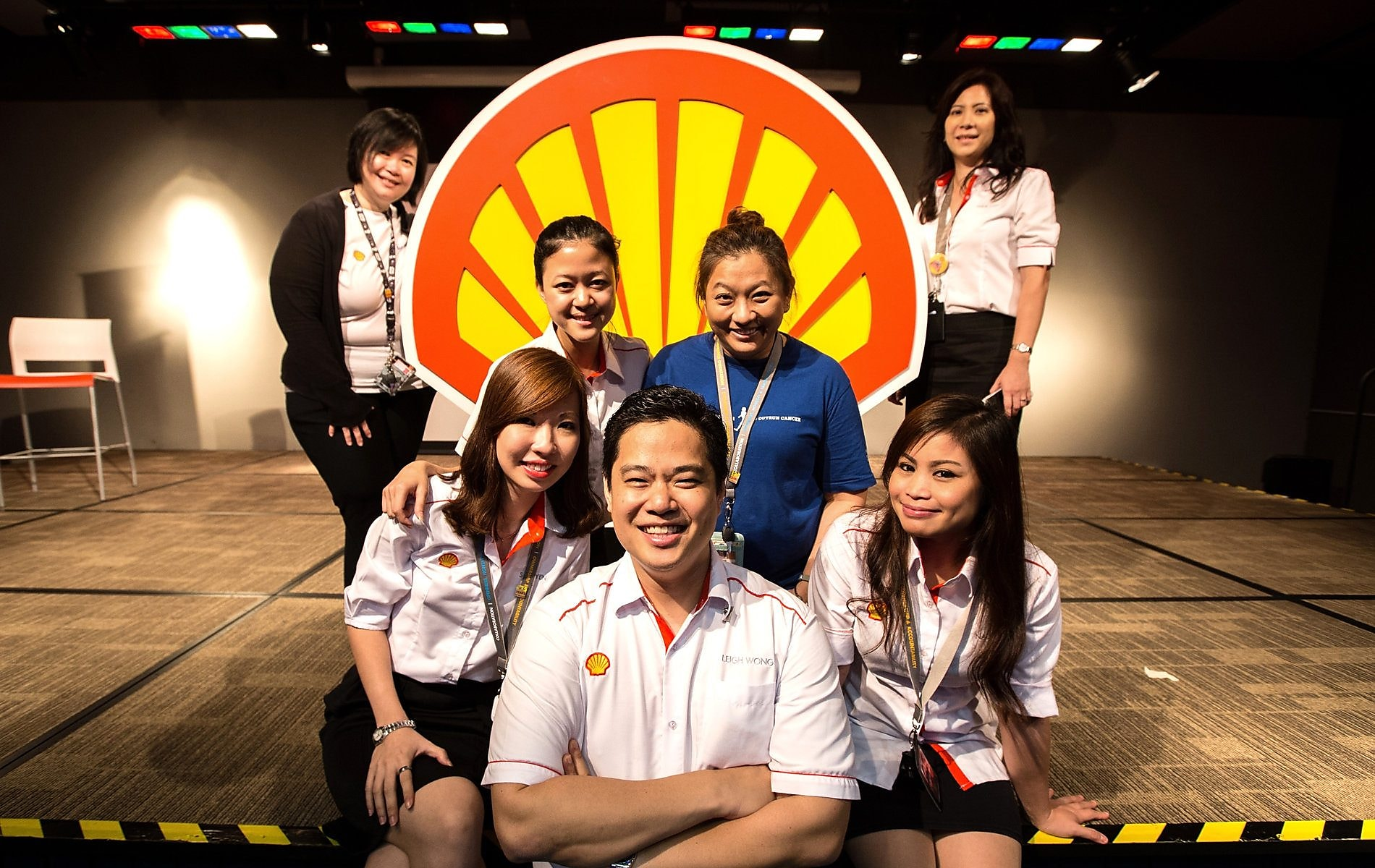 Siew Yen and colleagues pose in front of the Shell pecten