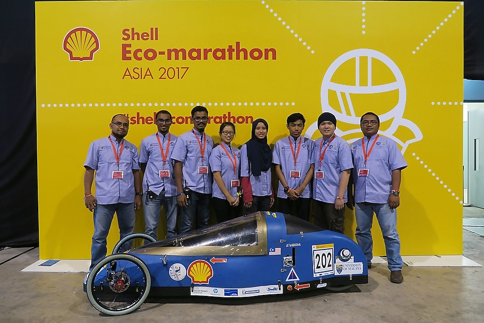 The Evora, #202, a hydrogen Prototype vehicle racing for team Eco-Voyager from University of Malaya, Malaysia poses for a team portrait during Make the Future Singapore 2017 at the Changi Exhibition Centre, Thursday, March 16, 2017 in Singapore. (Amal Amin for Shell)