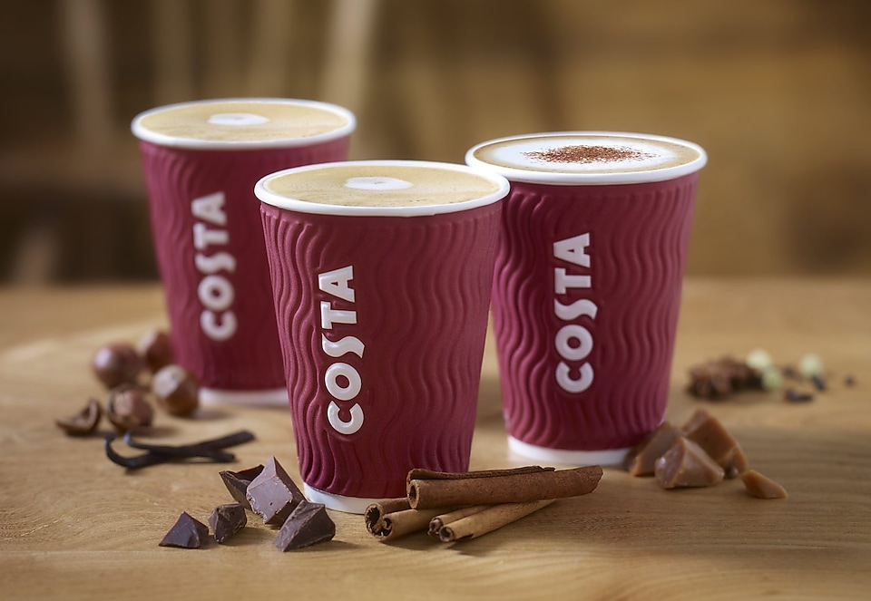 three mugs of Costa Coffee and Chocolate beside it