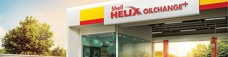 shell helix oil change plus with red car