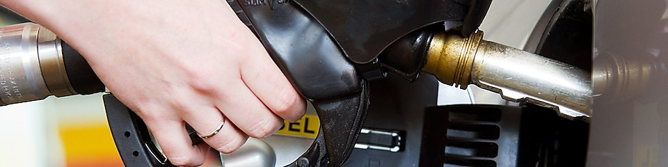 Hand refilling petrol with nozzle